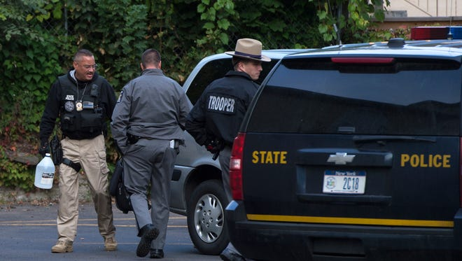 Law enforcement outside an apartment on Mckinley Avenue in Endicott during a raid Sept. 23, 2015.