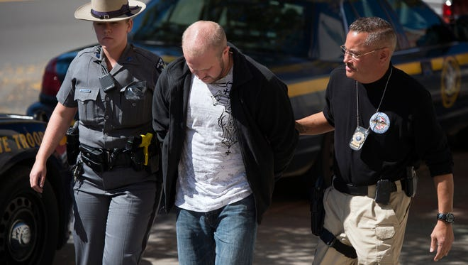 Derek Strassle, one of four men arrested, is brought to federal court in Binghamton to be arraigned in September.