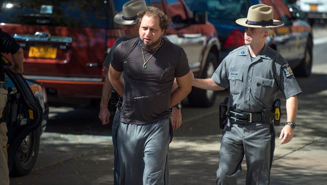 Richard Progovitz, one of four men arrested, is brought to federal court in Binghamton to be arraigned in September.