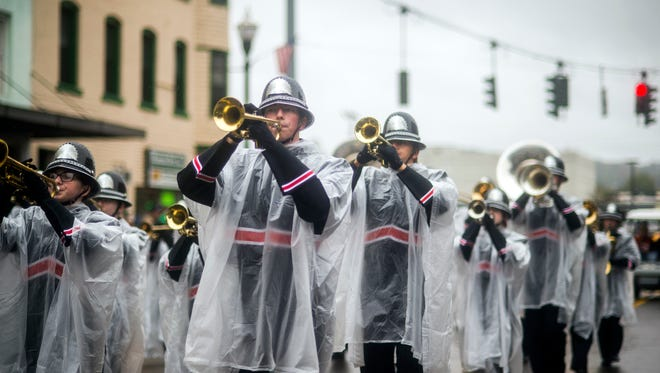 Members of the Union-Endicott marching band play during the U-E Homecoming Parade on Saturday.