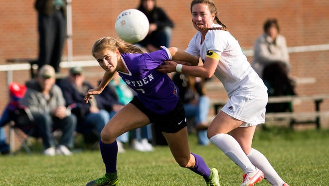 Dryden defender Taylor Bennett fights for possession of the ball with Seton Catholic Central midfielder Emily Purtell.