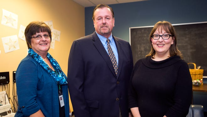 Central New York publisher Tom Claybaugh, center, with Essence Award winners Sally Henkiel, ad coordinator, left, and content coach Kristen Roby.