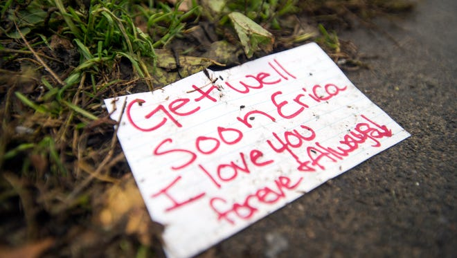A handwritten note to one of the victims of the arson fire at 145 Floral Ave. in Johnson City lies on the sidewalk at the scene of the Oct. 19 fire.
