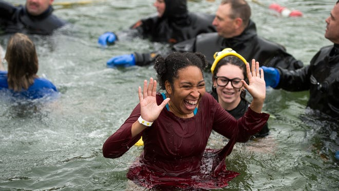 Binghamton University student Arlene Rogers, 21, reacts after jumping into the icy waters at Chenango Valley State Park on Saturday during the 4th Annual Binghamton Polar Plunge.