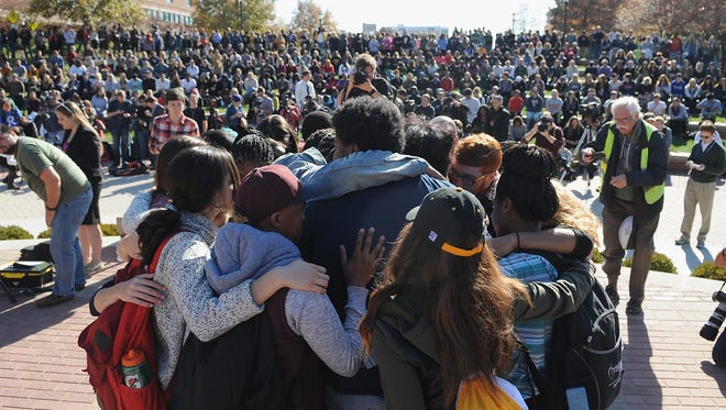 Students embrace one another during a forum on the campus of University of Missouri - Columbia on November 9, 2015 in Columbia, Missouri.