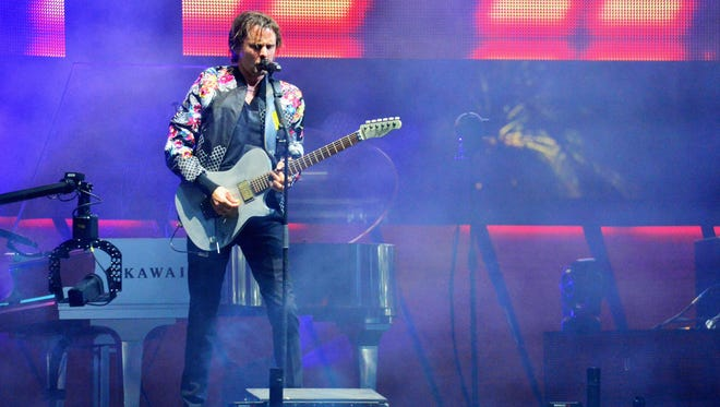 Matthew Bellamy of Muse performs onstage during day 2 of the 2014 Coachella Valley Music & Arts Festival at the Empire Polo Club on April 19, 2014 in Indio, California.