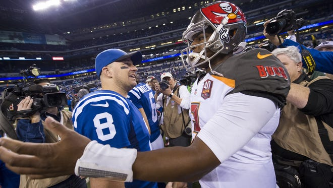 Indianapolis Colts quarterback Matt Hasselbeck (8) and Tampa Bay Buccaneers quarterback Jameis Winston (3) congratulate one another at midfield at the end of an NFL football game Sunday, Nov. 29, 2015, at Lucas Oil Stadium. Colts won 25-12.