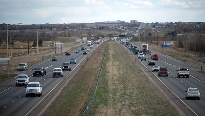 Traffic during rush hour on Interstate 25 as seen from the Harmony Road overpass..