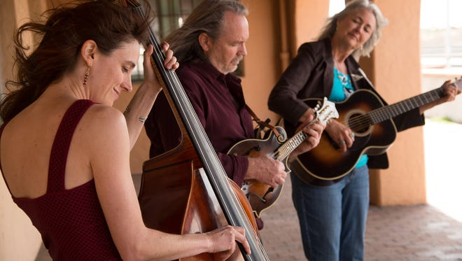 Hard Road Trio's Christine Sanders (guitar), Anne Luna (bass) and Steve Smith (mandolin) release their new album Saturday at an event at the Rio Grande Theatre.