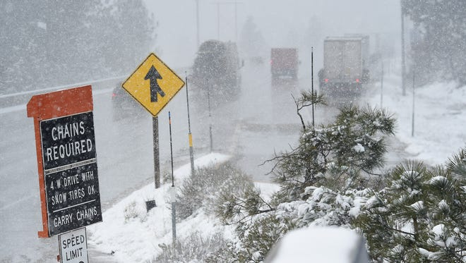 Vehicles make their way west on I-80 just past Truckee during a spring snow storm on April 7, 2015.
