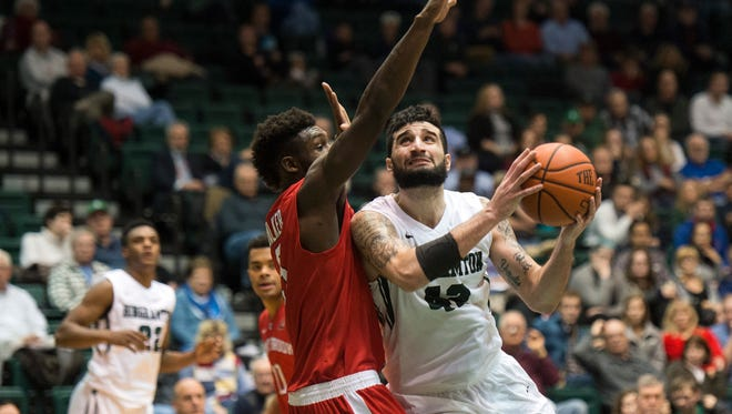 Binghamton University forward Willie Rodriguez backs into the paint against Stony Brook guard Ahmad Walker during the first half of BU's 62-52 loss at home on Wednesday, Jan. 6, 2016. Sophomore forward Bobby Ahearn paced the Bearcats with 13 points in the loss which dropped Binghamton to 3-11 on the season.