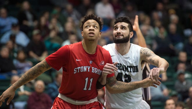 Binghamton University forward Willie Rodriguez fights for position under the basket during the Bearcat's 62-52 loss to Stony Brook at home on Wednesday, Jan. 6, 2016.