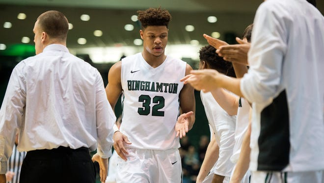 Binghamton University forward Thomas Bruce heads to the bench during the Bearcat's 62-52 loss to Stony Brook at home on Wednesday, Jan. 6, 2016.