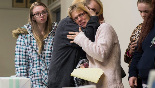 Bambi Madden's sisters, Marjorie Rought, left, hugs Jackie Fiske during a vigil on the 10th anniversary of Bambi's disappearance on Jan. 11.