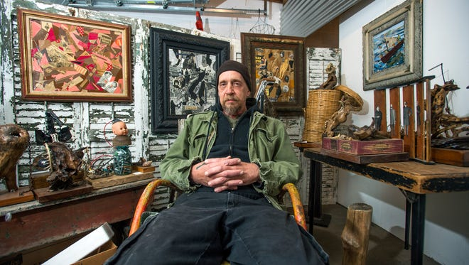Artist Don Sharpe, 57, in his garage studio behind his Binghamton home. Sharpe makes his pieces strictly from found materials like animal bones and scrap metal.