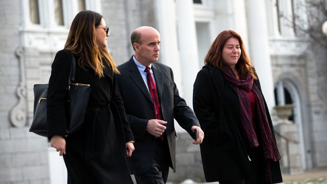 Cal Harris, center, leaves Schoharie County Court with attorneys Aida Leisenring, left, and Donna Aldea, following a pre-trial conference on Wednesday, Jan. 20, 2016.