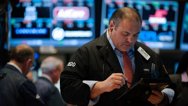 A trader works on the floor of the New York Stock Exchange on Jan. 21, 2016.   (Photo by Bryan Thomas/Getty Images)