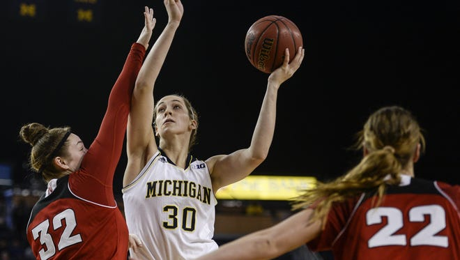 Michigan's Hallie Thome (30) tries to make a shot during the loss to Nebraska on Sunday at Crisler Center.