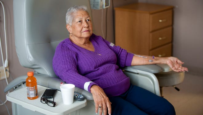 Augusta Thomas, 83, undergoes chemotherapy at the Norton Cancer Institute.23 January 2016