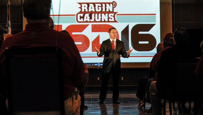 UL coach Mark Hudspeth gives fans the rundown on UL's new additions at last Wednesday night's signing bash. Feb 3, 2016.
