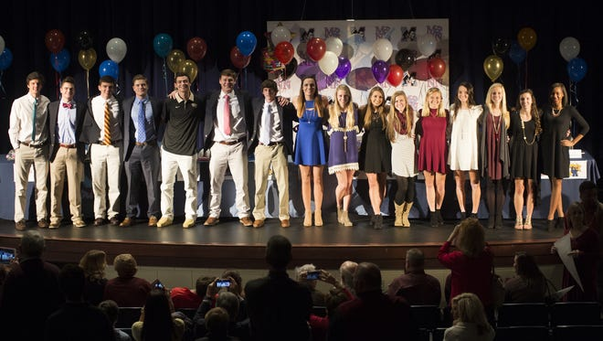 Seniors athletes at the J.L. Mann signing ceremony stand before the gathering in the school's auditorium Wednesday night.