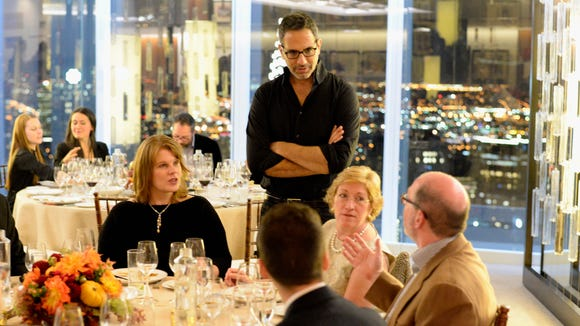 Chef John Tesar speaks with guests at A Mediterranean