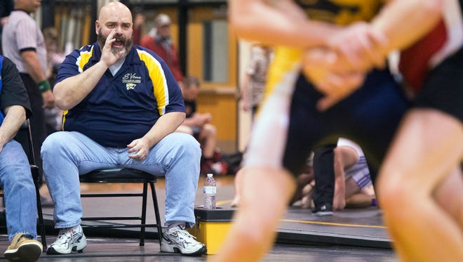Susquehanna Valley coach Jamie Lupole shouts advice as son Paddy wrestles Saturday in the Section 4 Class B Tournament at Windsor. Paddy is Jamie's middle son and the coach said he motivated all of his kids differently.