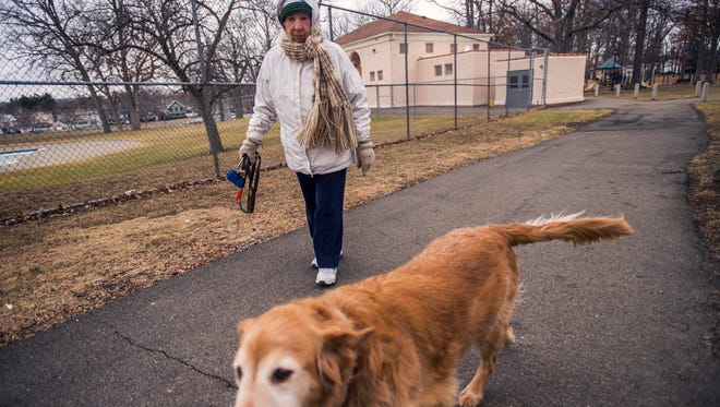 """Binghamton resident Barbara Cronkhite, 84, and her 9-year-old golden retriever Zephyr make one of their two daily walks through Recreation Park on Tuesday, Feb. 23. In his State of the City address Tuesday night, city Mayor Richard David called 2016 the """"year of the neighborhood,"""" and said the city will continue to invest in its parks."""