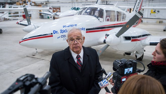 Dr. Richard Bedosky speaks to the media after it was announced Wednesday that he is donating his 1966 Piper Aztec airplane to SUNY Broome Community College.
