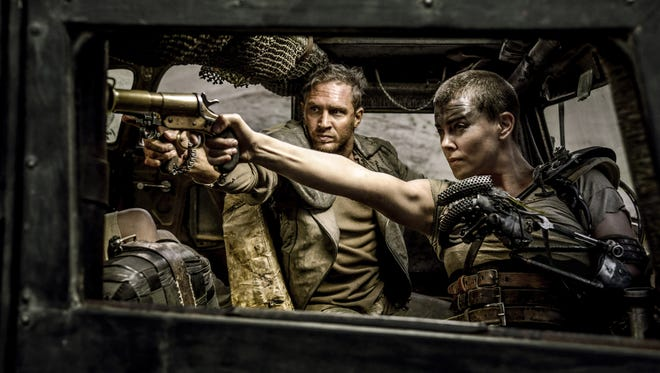 """Tom Hardy, left, and Charlize Theron in a scene from """"Mad Max:Fury Road."""""""