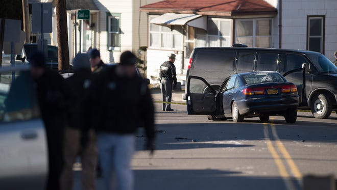 Police investigated the scene of shots fired on Glenwood Avenue early Thursday morning.