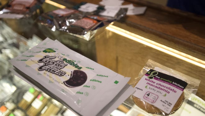 Marijuana-infused edible products are displayed at Organic Alternatives in Fort Collins in this 2014 file photo.