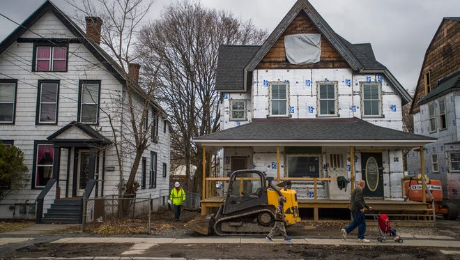Homes along Front Street are being rebuilt and renovated as part of the Binghamton Gateway Homes development project.