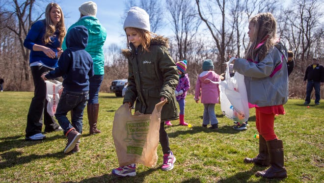 Children search for eggs with the winning numbers written on them during the 61st annual Apalachin Lions Club egg hunt at the BOCES West School in Apalachin on Saturday. The winners received a toy in addition to a chocolate bunny handed out to all the participants of the hunt.