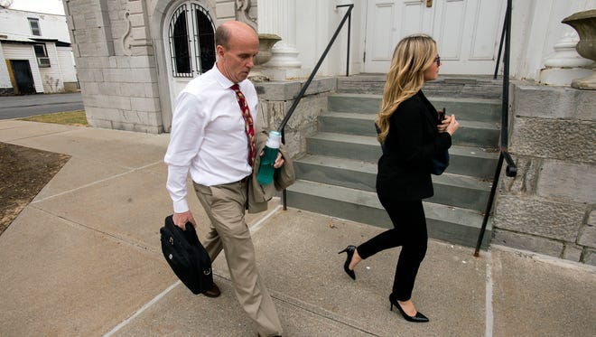 Cal Harris enters Schoharie County Court with his daughter Cayla before opening statements Thursday.