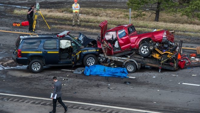 The scene of a two-vehicle accident involving a state police vehicle near Exit 76 on Route 17 East on Friday. One person is dead while the state trooper is being treated for injuries.