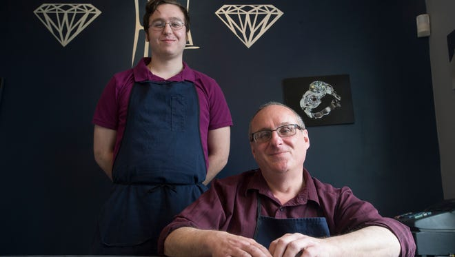 Frank Longo, right, owner of Frank Longo Originals, with his son Vito Longo inside their Johnson City jewelry store.