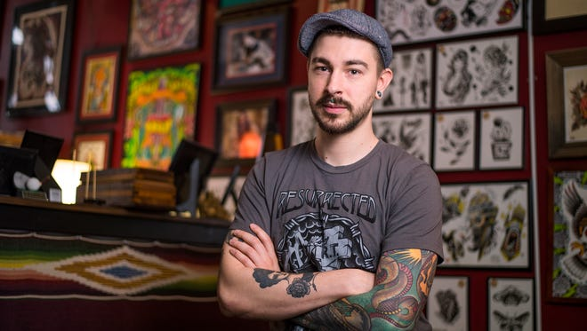 Tattoo artist Paul Ulrich, 28, of Binghamton, inside The Shaman's Den at 143 Washington St. in downtown Binghamton.