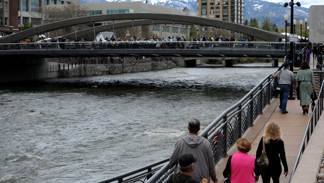People gather during the opening ceremony for the new Virginia Street Bridge in downtown Reno on April 12, 2016.