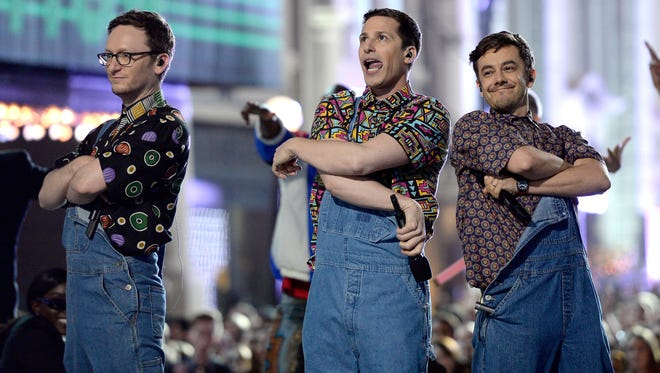 Actors Akiva Schaffer, Andy Samberg and Jorma Taccone of The Lonely Island perform onstage during the 2016 MTV Movie Awards at Warner Bros.