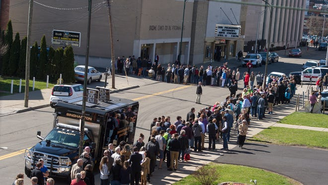 People wait in line to hear Republican presidential hopeful Ted Cruz speak with Fox News host Sean Hannity at the Forum in Binghamton on Friday, April 15, 2016.