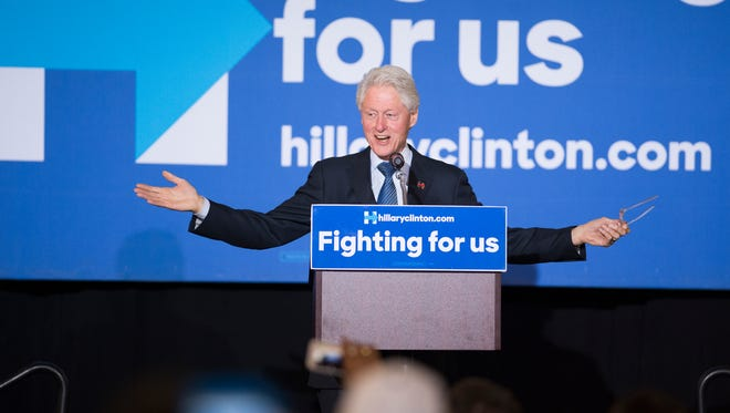 Former president Bill Clinton gestures during a speech campaigning on behalf of his wife Hillary, a Democratic presidential hopeful, at Binghamton University on Saturday, April 16, 2016.
