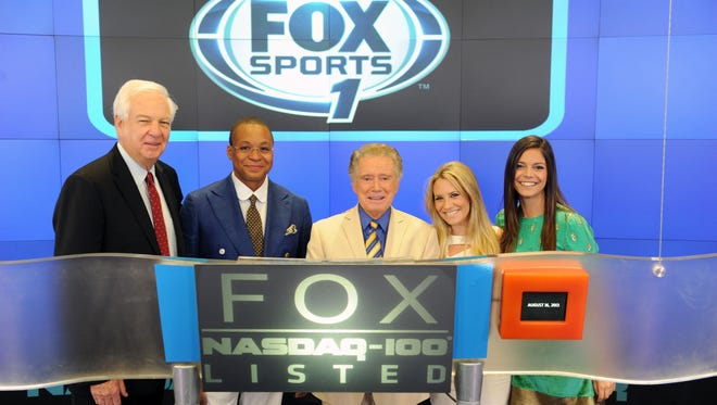 Fox personalities ring the opening bell at the NASDAQ MarketSite on Aug. 16, 2013 in New York.