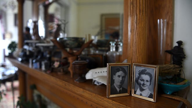 Portraits of past owners Merle and Mary Atcheson sit on the mantle at their home, now owned by Fred Atcheson, at  829 N. Center St. in Reno on March 8, 2016.
