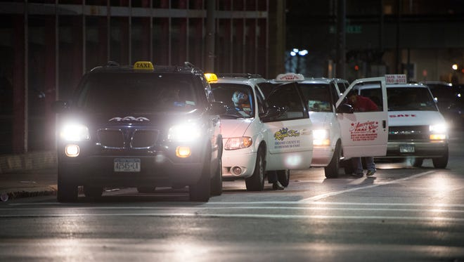Cabs line Hawley Street late on Saturday, April 30, 2016.