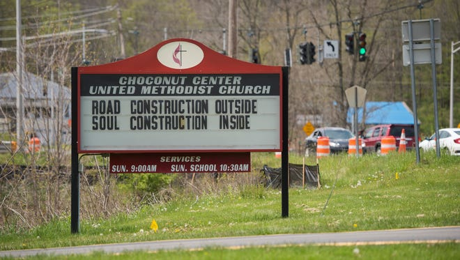 A sign at the Choconut Center United Methodist Church references the Airport Road Reconstruction project.