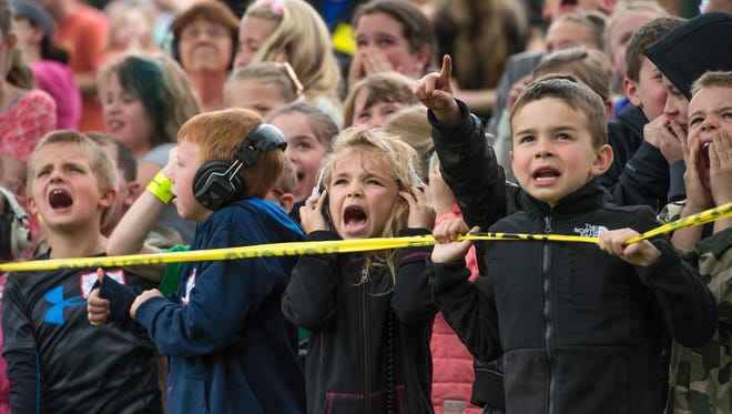 First-grade student Madison Kliment, center, reacts as a K-MAX helicopter lands on the field at Tioga Hills Elementary School on Friday afternoon.