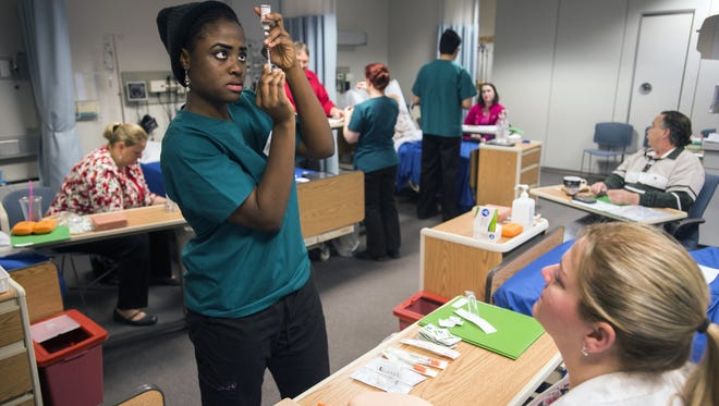 Nursing student Shaina Louis, 22, practices insulin injections at the Innovative Simulation and Practice Center at Binghamton University in February.