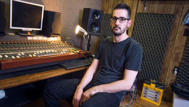 Audio engineer Mike Micha in his Johnson City mixing studio.