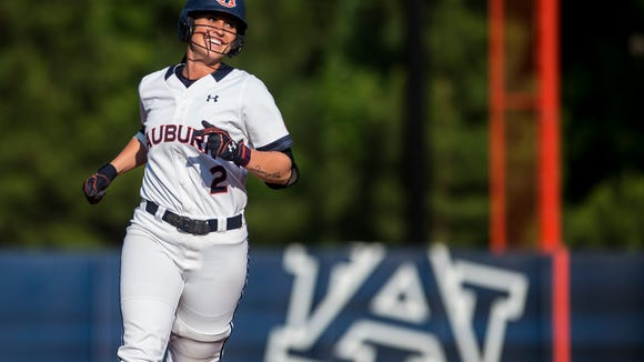 Auburn's Haley Fagan rounds the bases after hitting